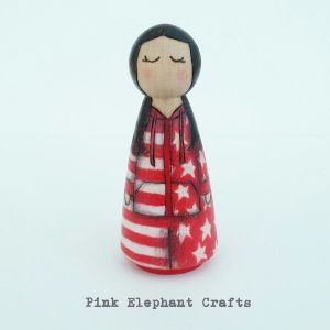 personalised peg doll wearing a onesie