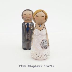 peg doll wedding cake topper