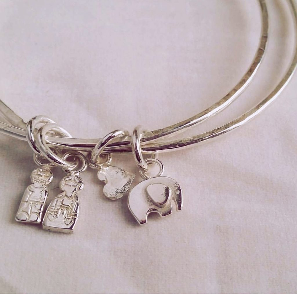 peg doll silver charms