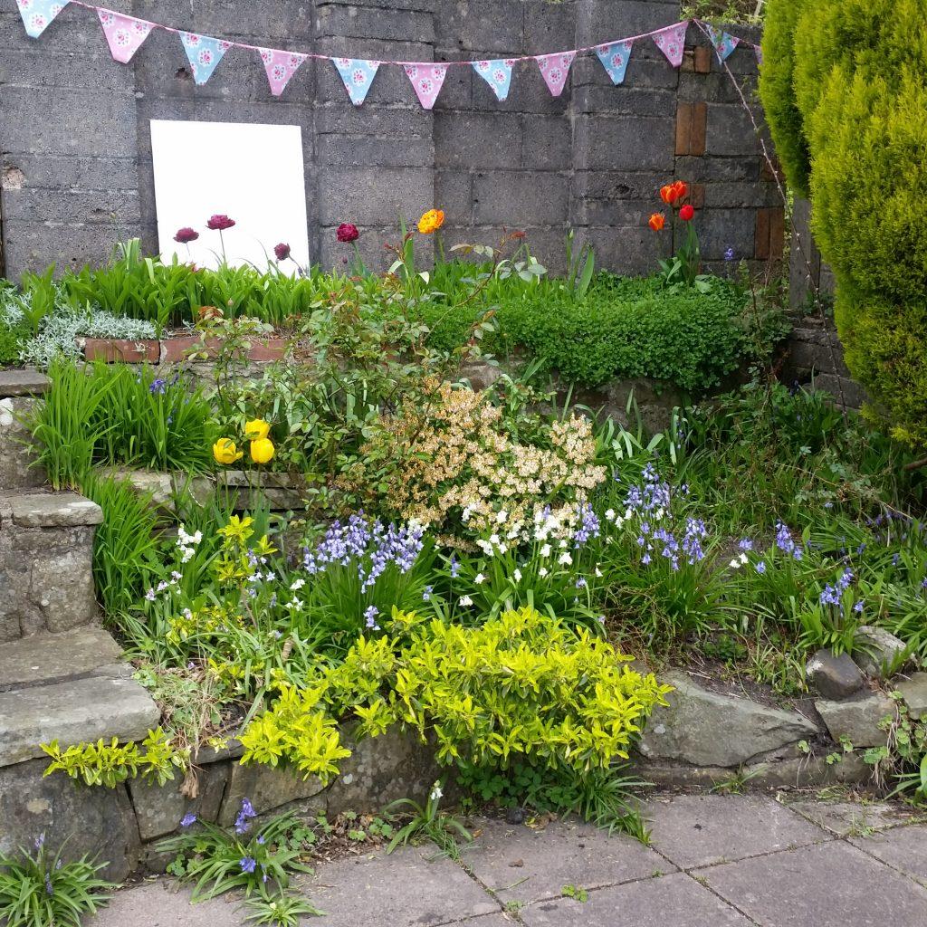 peg doll families int he Easter garden