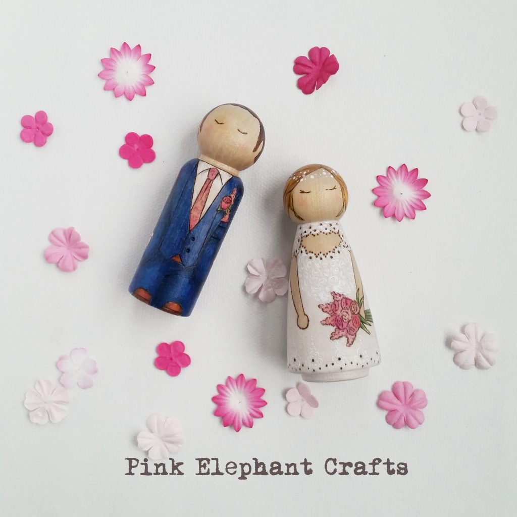 bride and groom peg doll wedding cake toppers