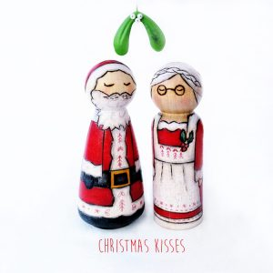 kissing under the misteltoe, mistletoe kisses, christmas mistletoe, christmas card, christmas kisses